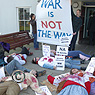 Anti-war protesters staging a 'mock death'.