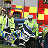 Police motorcyclist crash.