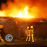 Firefighters tackling blaze at rugby club.