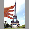 Eiffel Tower with large hand